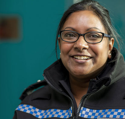 Image of Female Police Constable with glasses, smiling