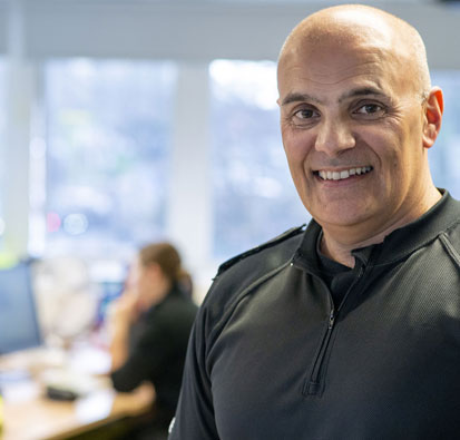 Image of Police Constable Phil Hamlani in the office